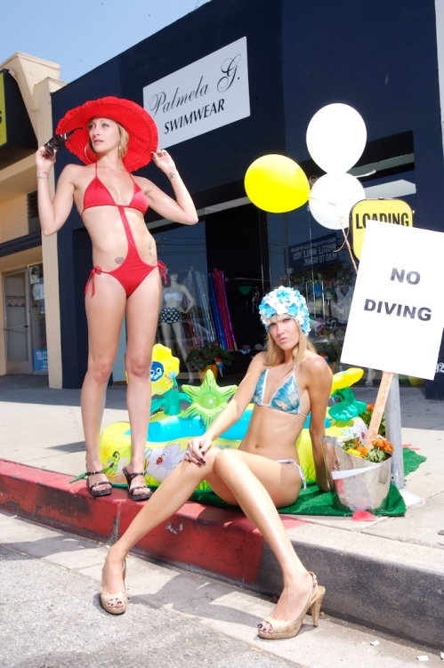 2 models rocking the side walk with custom swimsuits.